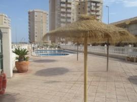Dúplex con piscina comunitaria