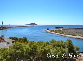 Urbanización Panoramic frente al Faro del Estacio y Puerto